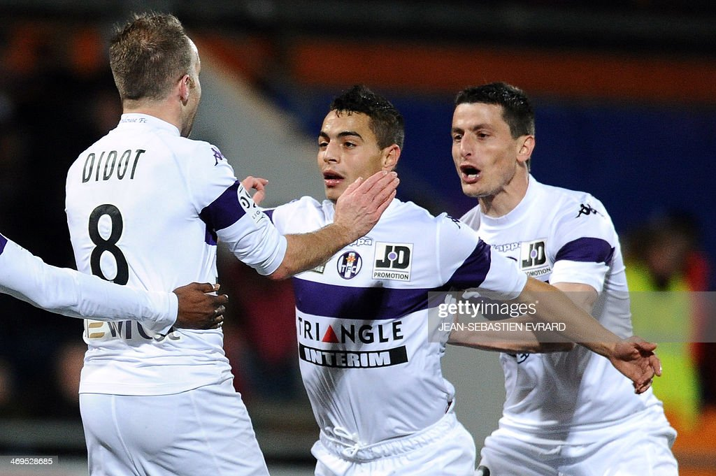 Toulouse's French forward Wissam Ben Yedder (C) celebrates after scoring a goal during the French L1 football match between Lorient and Toulouse on February 15, 2014 at the Moustoir stadium in Lorient, western France.