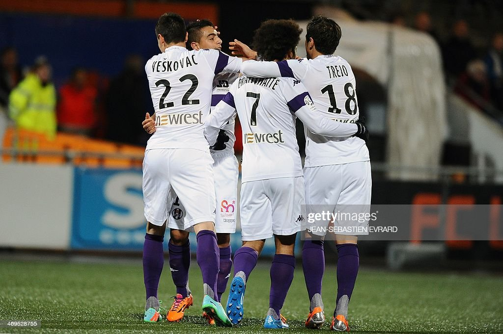 Toulouse's French forward Wissam Ben Yedder (2nd L) celebrates after scoring a goal with his teammates during the French L1 football match between Lorient and Toulouse on February 15, 2014 at the Moustoir stadium in Lorient, western France.