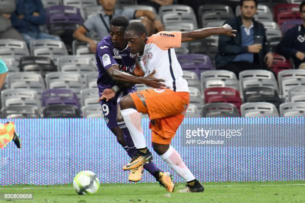 Toulouse's French forward Yaya Sanogo vies with Montpellier's French defender Nordi Mukiele during the French L1 football match Toulouse against...
