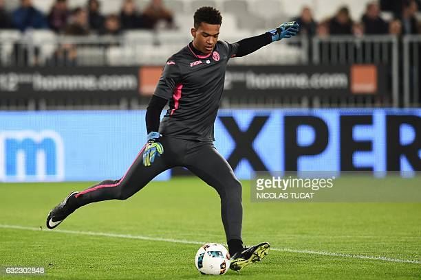Toulouse's French goalkeeper Alban Lafont kicks the ball during warm up prior to the French L1 football match Dijon vs Lille on January 21 at the...