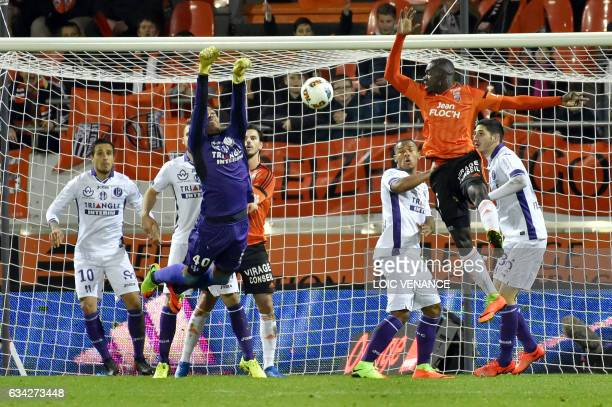 Toulouse's French goalkeeper Alban Lafont makes a save during the French L1 football match between Lorient and Toulouse at the Moustoir stadium in...
