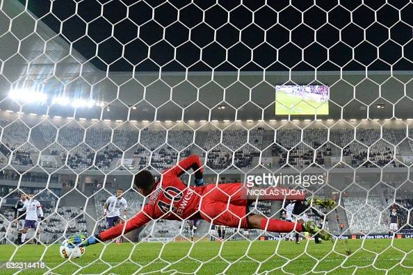 TOPSHOT Toulouse's French goalkeeper Alban Lafont stops a penalty during the French L1 football match between Bordeaux and Toulouse on January 21 at...