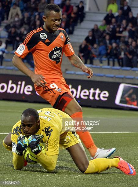Toulouse's French goalkeeper Zacharie Boucher grabs the ball next to Lorient's Ghanaian forward Jordan Ayew during the French L1 football match...