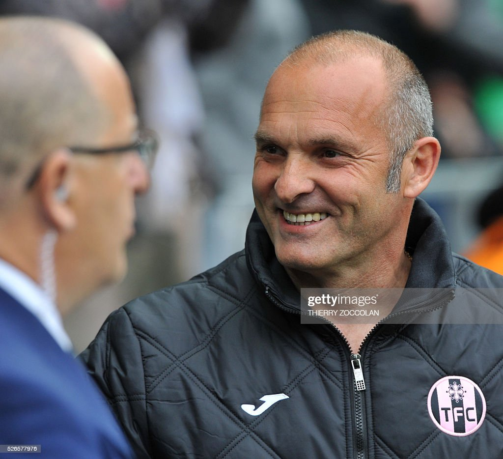 Toulouse's French head coach Pascal Dupraz (R) smiles as he attends the French L1 football match between Saint Etienne and Toulouse at the Geoffroy Guichard stadium in Saint Etienne, central France, on April 30, 2016.
