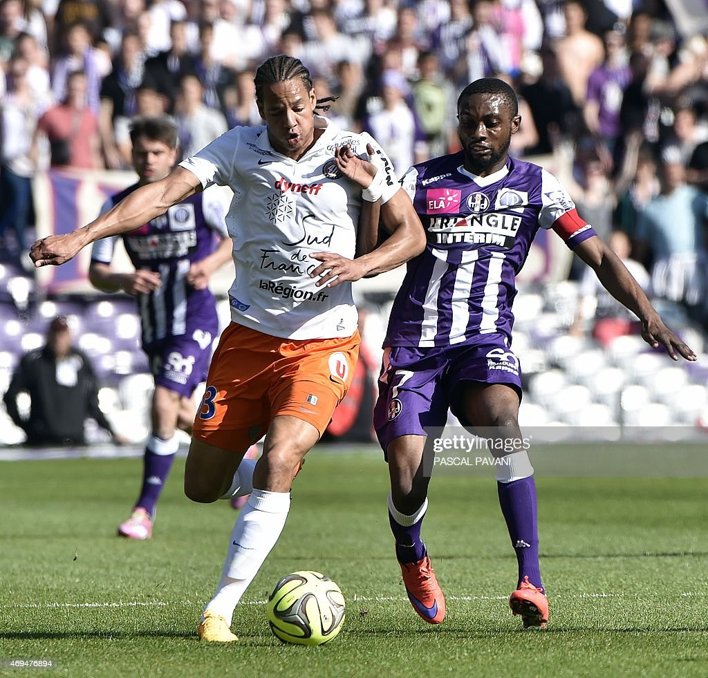 Toulouse's French Ivorian defender Jean Akpa-Akpro (R) vies with Montpellier's French defender <a gi-track='captionPersonalityLinkClicked' href=/galleries/search?phrase=Daniel+Congre&family=editorial&specificpeople=2167788 ng-click='$event.stopPropagation()'>Daniel Congre</a> (L) during the French L1 football match Toulouse against Montpellier on April 12, 2015 at the Municipal Stadium in Toulouse.