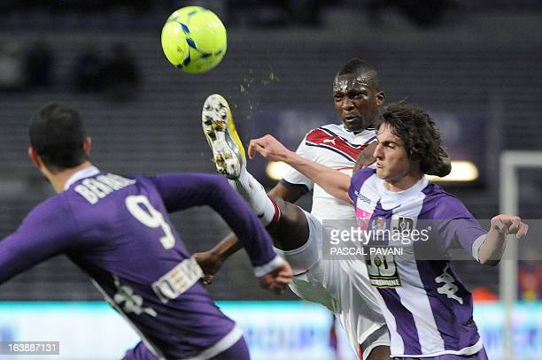 Toulouse's French midfielder Adrien Rabiot vies with Bordeaux's Malian midfielder Abdou Traore during the French L1 football match Toulouse vs...