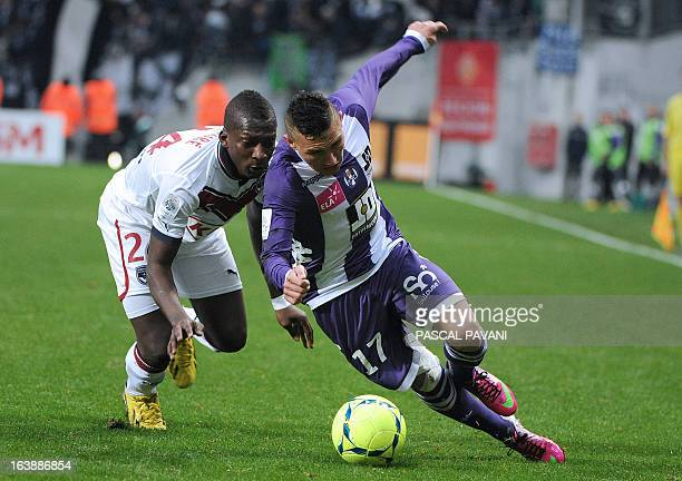 Toulouse's French midfielder Adrien Regattin vies for the ball with Bordeaux's Malian midfielder Abdou Traore during the French L1 football match...