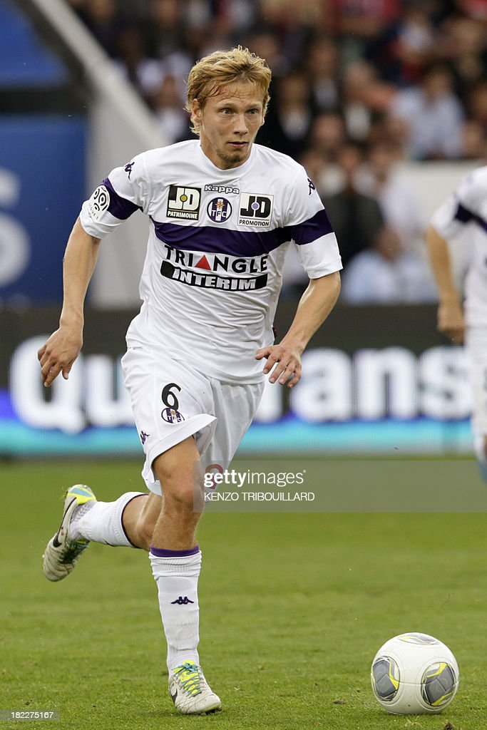 Toulouse's French midfielder Clement Chantome runs with the ball during the French L1 football match between Paris Saint-Germain and Toulouse at the Parc des Princes Stadium in Paris on September 28, 2013. PSG won 2-0.