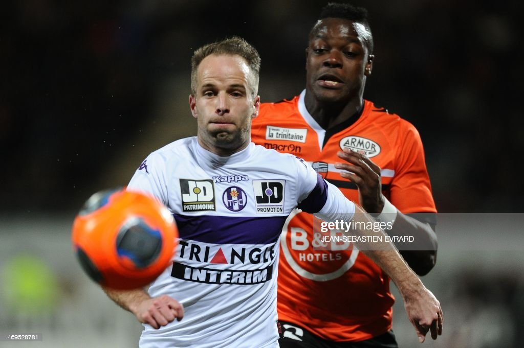 Toulouse's French midfielder Etienne Didot (L) vies with Lorient's French defender Kone Lamine during the French L1 football match between Lorient and Toulouse on February 15, 2014 at the Moustoir stadium in Lorient, western France.