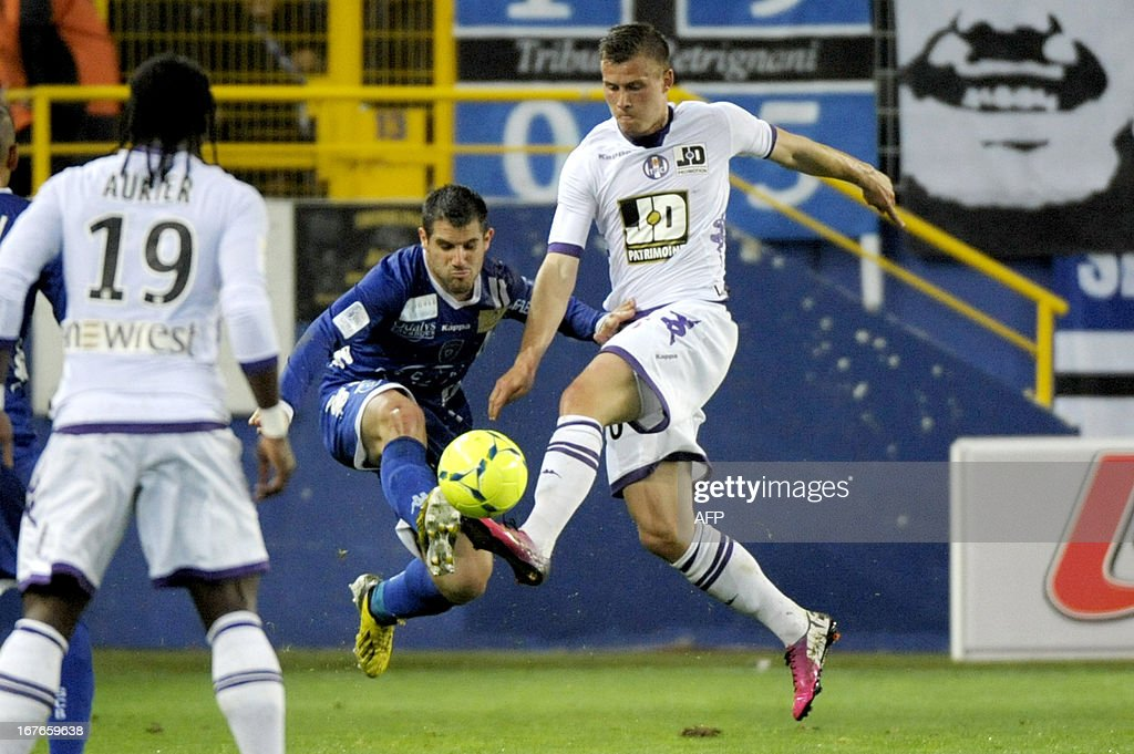 Toulouse's French midfielder Franck Tabanou vies with Bastia's Algerian defender Fethi Harek during the French L1 football match Bastia vs Toulouse...