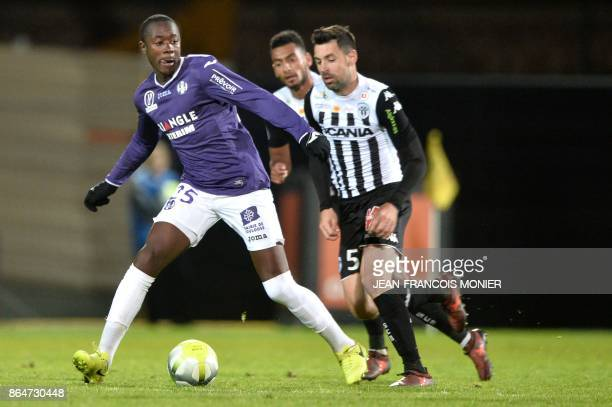 Toulouse's French midfielder Giannelli Imbula vies with Angers' French midfielder Thomas Mangani during the French L1 Football match between Angers...