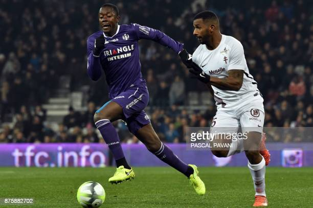 Toulouse's French midfielder Giannelli Imbula vies with Metz's Portuguese midfielder Miguel Cafu during the French L1 football match between Toulouse...