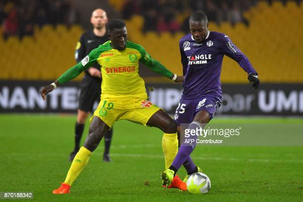 Toulouse's French midfielder Giannelli Imbula vies with Nantes' French midfielder Abdoulaye Toure during the French L1 football match Nantes versus...