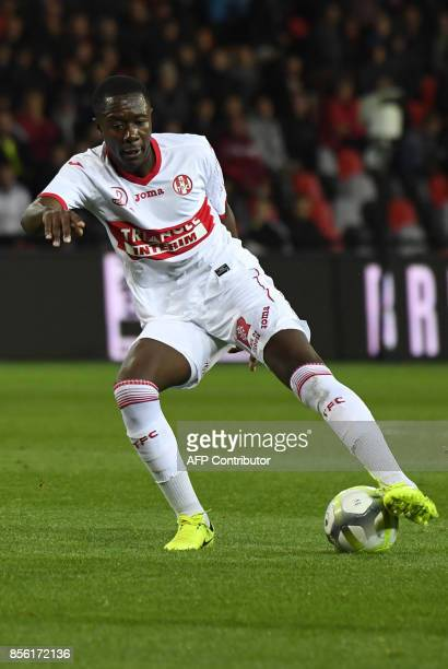 Toulouse's French midfielder Gilbert Imbula Wanga plays the ball during the French L1 football match Guingamp against Toulouse on September 30 2017...