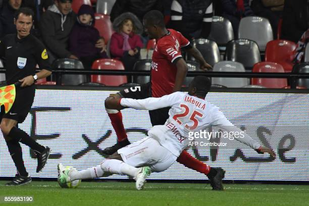 Toulouse's French midfielder gilbert Imbula Wanga tackles Guingamp's Senegalese midfielder Moustapha Diallo during the French L1 football match...