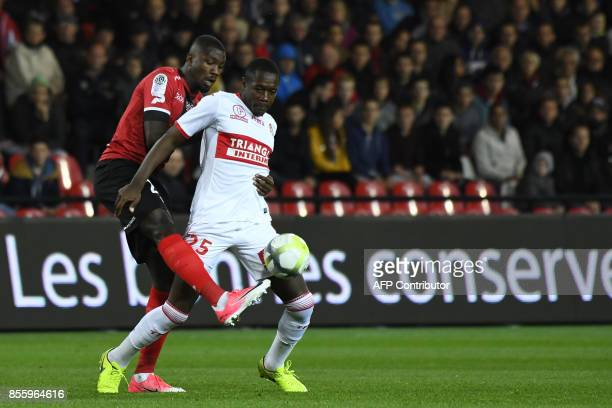 Toulouse's French midfielder gilbert imbula wanga vies with Guingamp's French forward Marcus Thuram during the French L1 football match Guingamp...