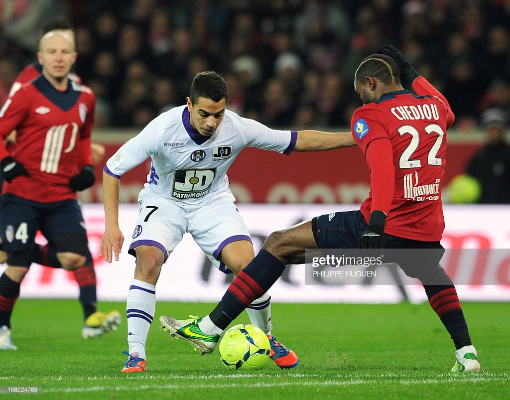 Toulouse's French midfielder Wissam Ben Yedder (C) vies for the ball with Lille's Cameroonian midfielder Aurelien Chedjou during the French L1 football match Lille vs Toulouse on December 11, 2012 at the Grand Stade Stadium in Villeneuve d'Ascq, near Lille. AFP PHOTO / PHILIPPE HUGUEN