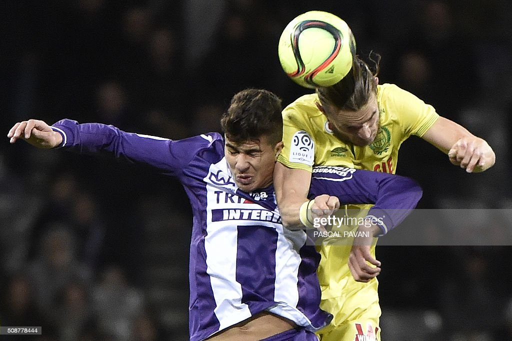 Toulouse's French midfielder Zinedine Machach vies with Nantes' Argentinian forward Emiliano Sala (up) during the French L1 football match Toulouse against Nantes on February 6, 2016 at the Municipal Stadium in Toulouse. AFP PHOTO / PASCAL PAVANI / AFP / PASCAL PAVANI