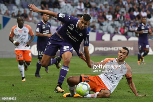 Toulouse's French midfielder Zinedine Machache fights for the ball with Montpellier's French midfielder Ellyes Skhiri during the French L1 football...