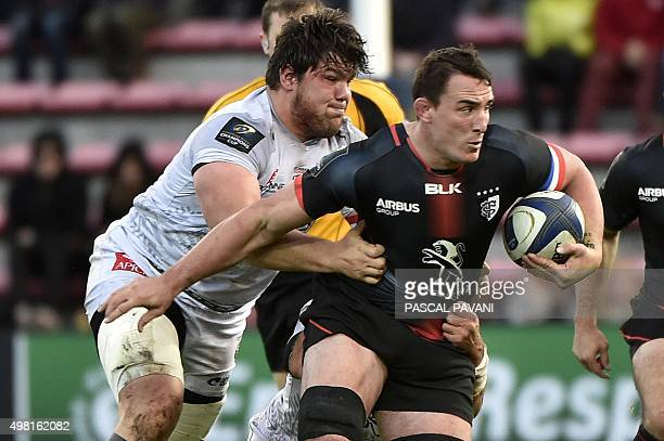 Toulouse's French number eight Louis Picamoles breaks away from Oyonnax' French prop Antoine Guillamont during the European Rugby Union Champions Cup...