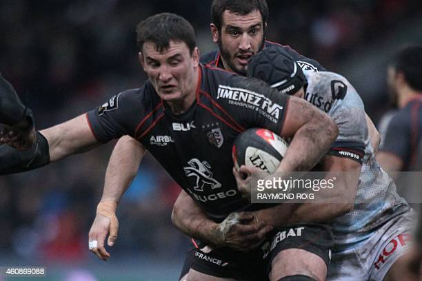 Toulouse's French number eight Louis Picamoles is tackled by RacingMetro's hooker Juandre Kruger during the French Top 14 rugby union match Toulouse...