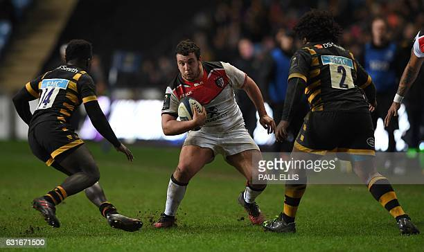 Toulouse's French prop Dorian Aldegheri vies with Wasps' English wing Christian Wade and Wasps' South African hooker Ashley Johnson during the...
