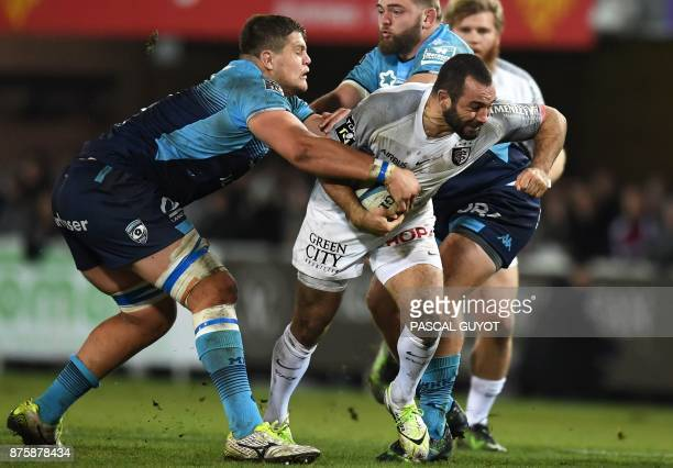 Toulouse's French scrumhalf Jean Marc Doussain vies with Montpellier's French lock Paul Willemse during the French Top 14 rugby union match between...
