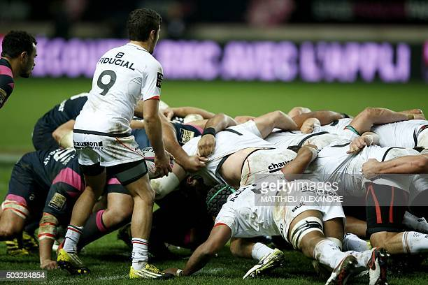 Toulouses French scrumhalf Sebastien Bezy prepares to feed the ball during the French Top 14 rugby union match Stade Francais versus Stade Toulousain...