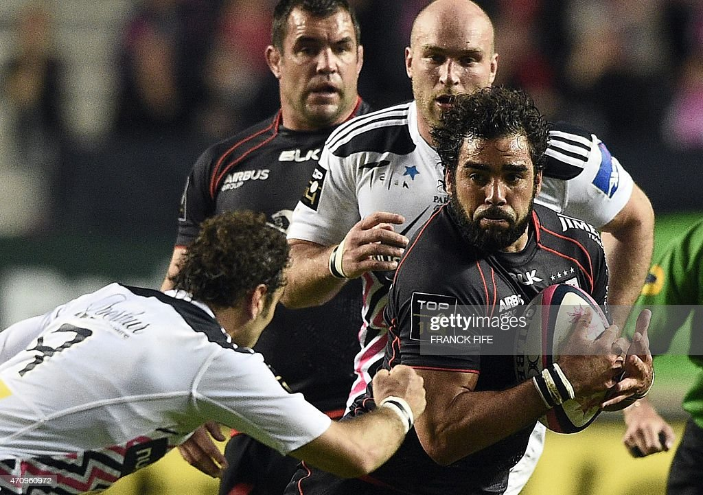 Toulouse's French winger <a gi-track='captionPersonalityLinkClicked' href=/galleries/search?phrase=Yoann+Huget&family=editorial&specificpeople=683912 ng-click='$event.stopPropagation()'>Yoann Huget</a> (R) vies with Paris' French scrum-half <a gi-track='captionPersonalityLinkClicked' href=/galleries/search?phrase=Jerome+Fillol&family=editorial&specificpeople=698636 ng-click='$event.stopPropagation()'>Jerome Fillol</a> (L) during the French Top 14 rugby match between Stade Francais Paris and Toulouse on April 24, 2015, at the Jean Bouin stadium in Paris.