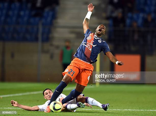 Toulouse's FrenchMoroccan midfielder Adrien Regattin vies with Montpellier's French defender William Remy during the French L1 football match between...