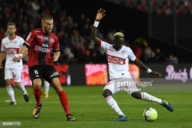 Toulouse's Guinean defender Issiaga Sylla kicks the ball despite Guingamp's French midfielder Lucas Deaux during the French L1 football match...