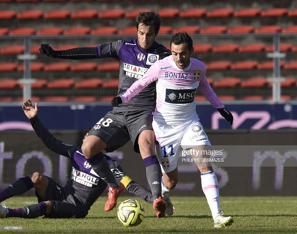 Toulouse's Italian Argentinian midfielder <a gi-track='captionPersonalityLinkClicked' href=/galleries/search?phrase=Oscar+Trejo&family=editorial&specificpeople=4299750 ng-click='$event.stopPropagation()'>Oscar Trejo</a> (L) vies with Evian's French midfielder <a gi-track='captionPersonalityLinkClicked' href=/galleries/search?phrase=Fabien+Camus&family=editorial&specificpeople=5702744 ng-click='$event.stopPropagation()'>Fabien Camus</a> (R) during the French L1 football match Evian Thonon Gaillard against Toulouse FC on January 25, 2015 at the Parc des Sports stadium in Annecy, eastern France. AFP PHOTO/PHILIPPE DESMAZES