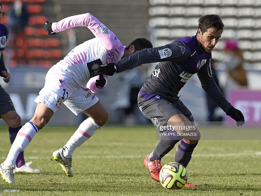 Toulouse's Italian Argentinian midfielder <a gi-track='captionPersonalityLinkClicked' href=/galleries/search?phrase=Oscar+Trejo&family=editorial&specificpeople=4299750 ng-click='$event.stopPropagation()'>Oscar Trejo</a> (R) vies with Evian's French midfielder <a gi-track='captionPersonalityLinkClicked' href=/galleries/search?phrase=Fabien+Camus&family=editorial&specificpeople=5702744 ng-click='$event.stopPropagation()'>Fabien Camus</a> during the French L1 football match Evian Thonon Gaillard against Toulouse FC on January 25, 2015 at the Parc des Sports stadium in Annecy, eastern France. AFP PHOTO / PHILIPPE DESMAZES
