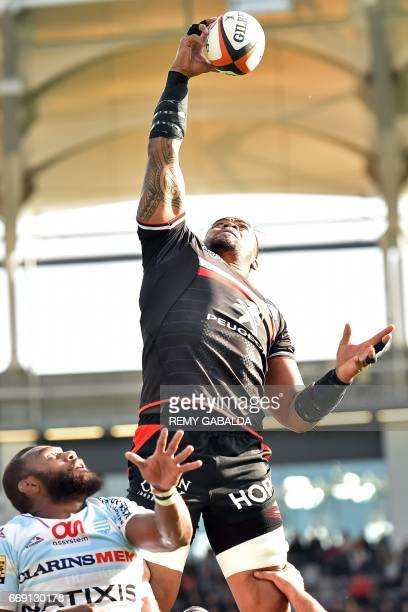 Toulouse's lock Iosefa Tekori grabs the ball in a line out during the French Top 14 rugby union match between Stade Toulousain and Racing 92 on April...