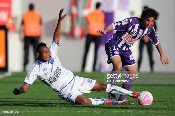 Toulouse's midfielder Gilles Siriex vies with Auxerre's midfielder Kossi Segbefia during the French L1 football match Toulouse vs Auxerre on March 25...