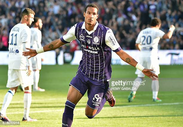 Toulouse's mildfielder Christopher Jullien celebrates after scoring a goal during the French Ligue 1 football match between Toulouse and Olympique...
