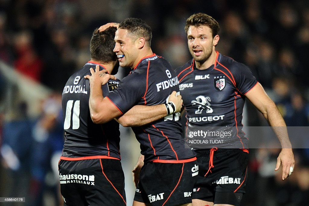 Toulouse's New Zealander fly half Luke McAlister celebrates with teammates at the end of the French Top 14 rugby union match between Union...