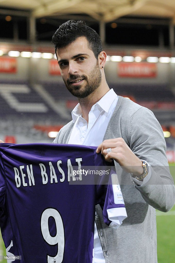 Toulouse's newly-recruited Israeli forward Eden Ben Basat poses with his new jersey on February 1, 2013 in Toulouse. Formerly playing at Brest football club (SB 29), Ben Basat signed a four-year and a half contract with Toulouse football club (TFC), the club's said today on his official website.