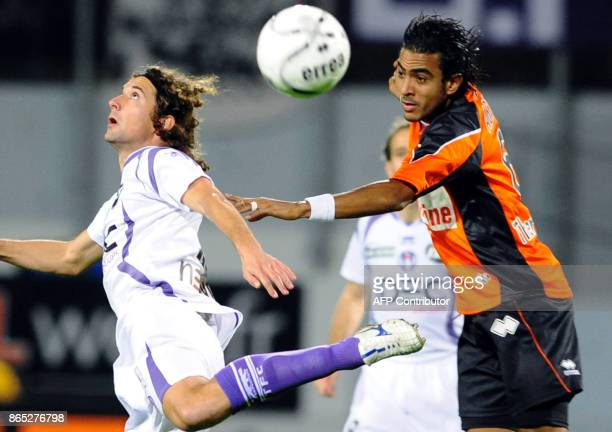 Toulouse's Pantxi Gilles Sirieix vies with Lorient's Fabrice Abriel during the French L1 football match Lorient vs Toulouse on November 22 2008 at...