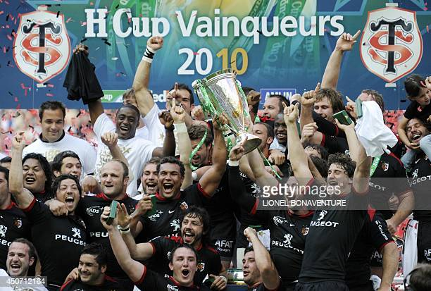 Toulouse's players celebrate with the trophy after winning against Biarritz at the end of the European Rugby Union HCup final on May 22 2010 at Stade...