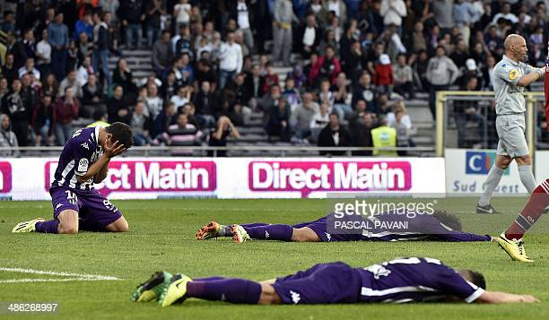 Toulouse's players react after the French L1 football match between Toulouse and Lyon on April 23 2014 at the Municipal Stadium in Toulouse southern...