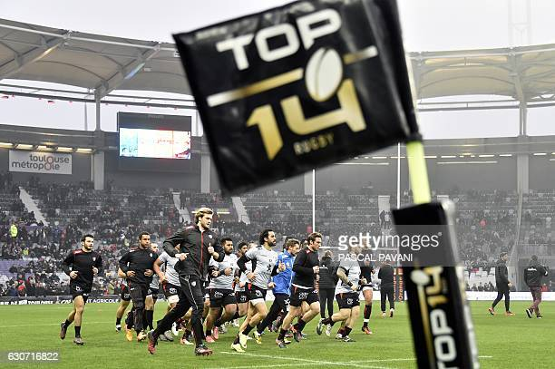 Toulouse's players warm up before the French Top 14 rugby union match Toulouse vs Clermont on December 31 2016 at the Municipal Stadium in Toulouse /...