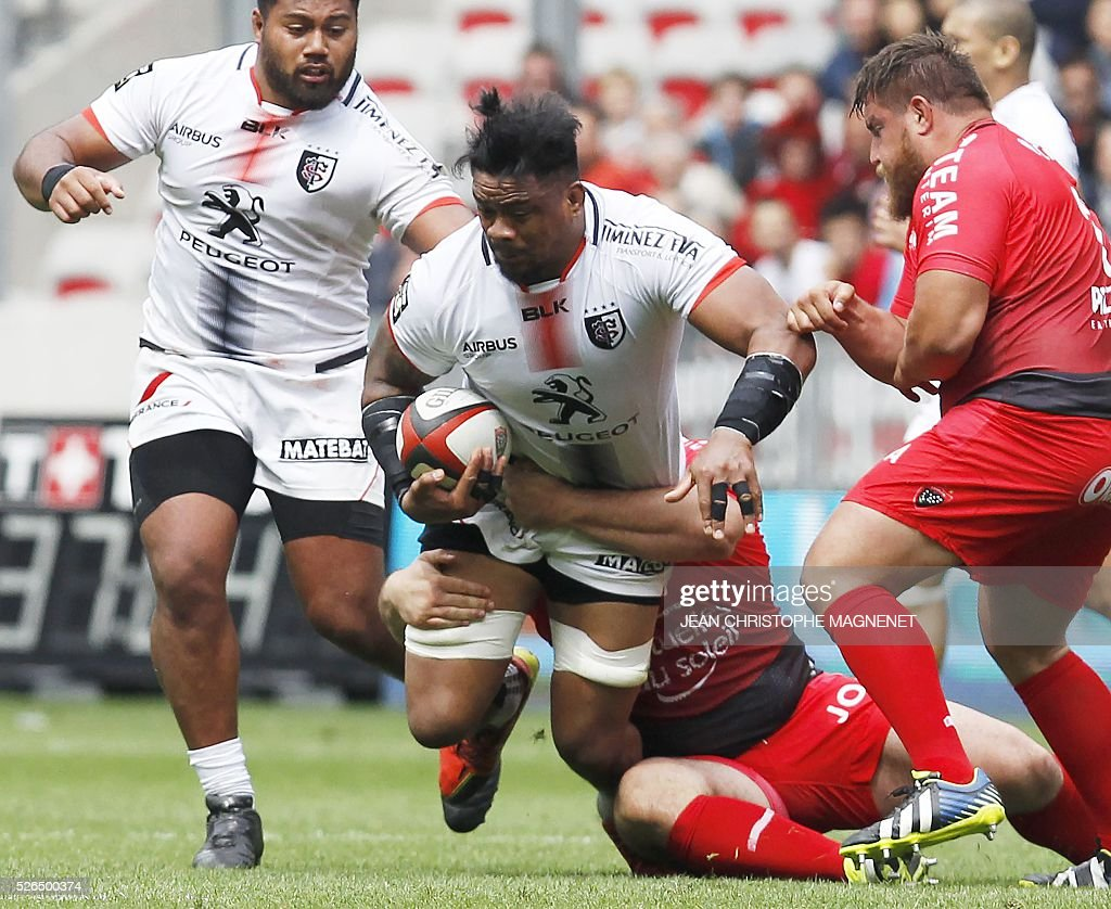 Toulouse's Samoan prop Census Johnston is tackled during the French Top 14 rugby union match Toulon vs Toulouse on April 30, 2016 at the 'Allianz Riviera' stadium in Nice, southeastern France.