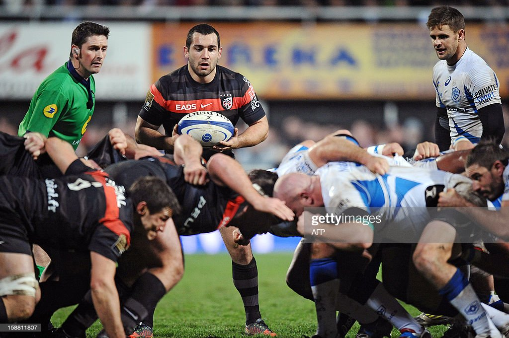 Toulouse's scrum half Jean-Marc Doussain (C, background) looks at an engagement of the scrum during the Top 14 rugby match between Castres Olympique and Stade Toulousain, on December 30, 2012, at the Pierre Antoine stadium in Castres.