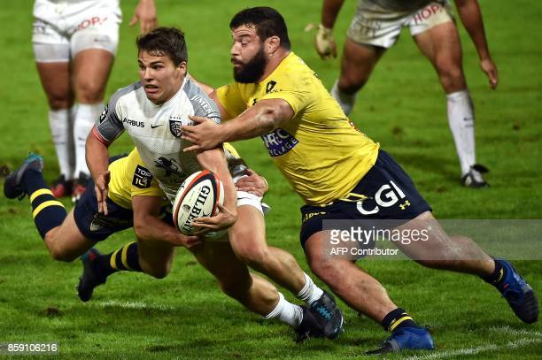TOPSHOT Toulouse's scrumhalf Antoine Dupont is tackled by Clermont's prop Rabah Slimani during the French Top 14 rugby union match Stade Toulousain...