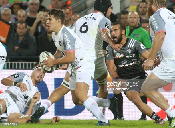 Toulouse's scrumhalf Antoine Dupont runs with the ball during the French Top14 rugby union match CA Brive versus Toulouse on September 23 2017 at the...