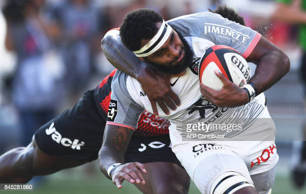 Toulouse's Semi Tani Qerelevu Kunabuli vies with RC Toulon's French winger Chris Ashton during the French Top 14 rugby union match Toulon vs Toulouse...