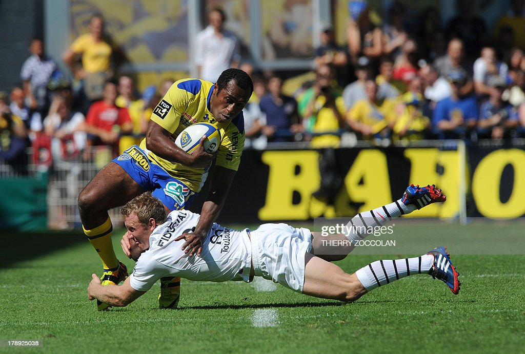 Toulouse's South African scrum-half Jano Vermaak (below) tackles Clermont's Fijian winger Sitiveni Sivivatu during the French Top 14 rugby Union match ASM Clermont Auvergne vs Stade Toulousain on August 31, 2013 at the stadium Marcel Michelin in Clermont-Ferrand, central France.