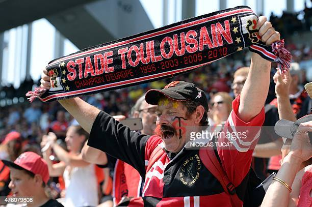 Toulouse's supporters cheer before the start of French Top 14 rugby union semifinal match between Clermont and Toulouse on June 6 2015 at the Nouveau...
