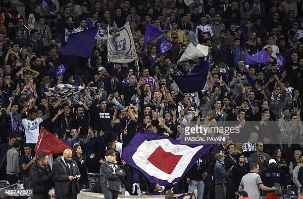 Toulouse's supporters cheer their team during the French L1 football match Toulouse vs Marseille on September 23 2015 at the Municipal Stadium in...